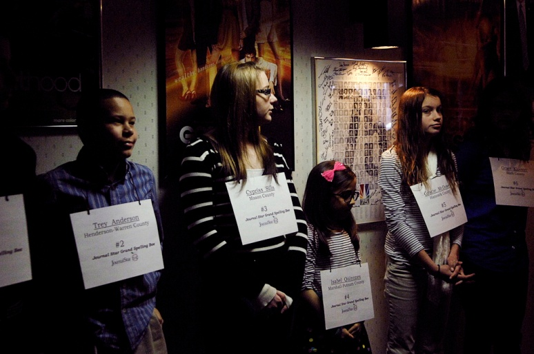 NICK SCHNELLE/JOURNAL STAR  Students line up along a wall before entering the studio on Friday before the start of the Grand Final Bee spelling competition held at the studios of WEEK-TV, Channel 25.