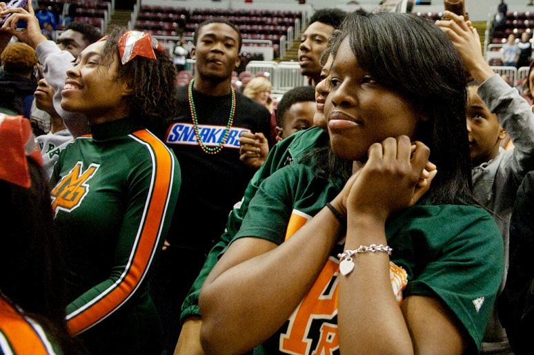 NICK SCHNELLE/JOURNAL STAR  Imani Strong watches as players are presented with their medals after Chicago Morgan Park defeated Cahokia 63-48 on Saturday to win the IHSA Class 3A state title at Carver Arena.