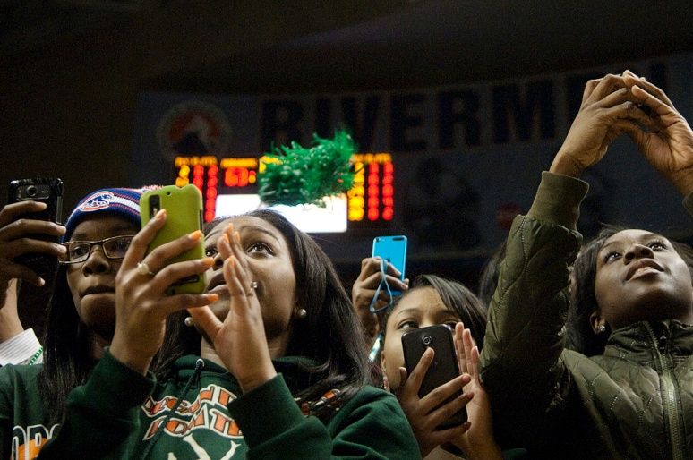 NICK SCHNELLE/JOURNAL STAR  Chicago Morgan Park fans take pictures of the trophy and medal ceremony after Chicago Morgan Park defeated Cahokia 63-48 on Saturday to win the IHSA Class 3A state title at Carver Arena.