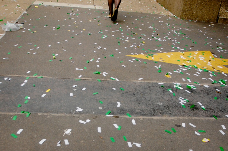 NICK SCHNELLE/JOURNAL STAR  Confetti covers the sidewalk on Sunday during the St. Patrick's Day parade on Main Street in downtown Peoria.