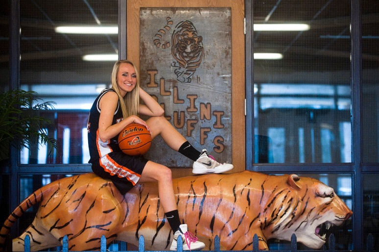 NICK SCHNELLE/JOURNAL STAR  Small-school girls basketball POY Taylor McClintock of Illini Bluffs poses with her 3000th point basketball at Illini Bluffs High School.