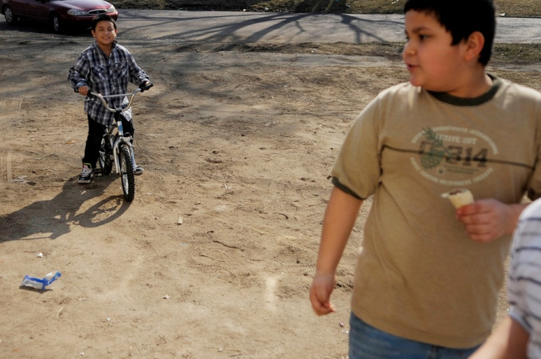 NICK SCHNELLE/JOURNAL STAR  Benny Vargas, 8, left, plays on a bike during warmer weather on Saturday afternoon outside a home on the 1000 block of Northeast Jefferson Avenue.