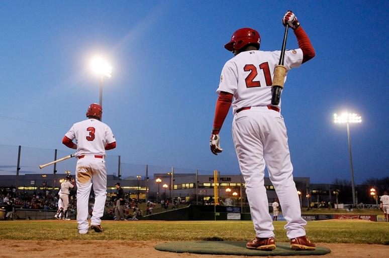 NICK SCHNELLE/JOURNAL STAR  From left, Peoria Chiefs outfielder Nick Martini and catcher Gerwuins Velazco wait for their at bat during the home opener against the Wisconsin Timber Rattlers on Thursday afternoon at Peoria Chiefs Stadium.